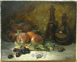 Tableau ancien nature morte aux péches et raisins, bouteilles. Signé E. MEYER